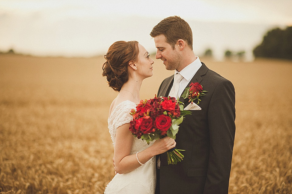 Red Roses In Her Hair For A Relaxed and Rural Farm Wedding