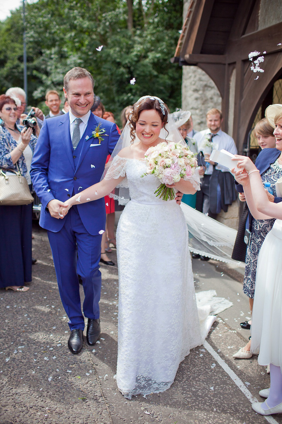 A Railway Museum Wedding with an Elegant Handmade Lace Gown and Maids in Navy Blue