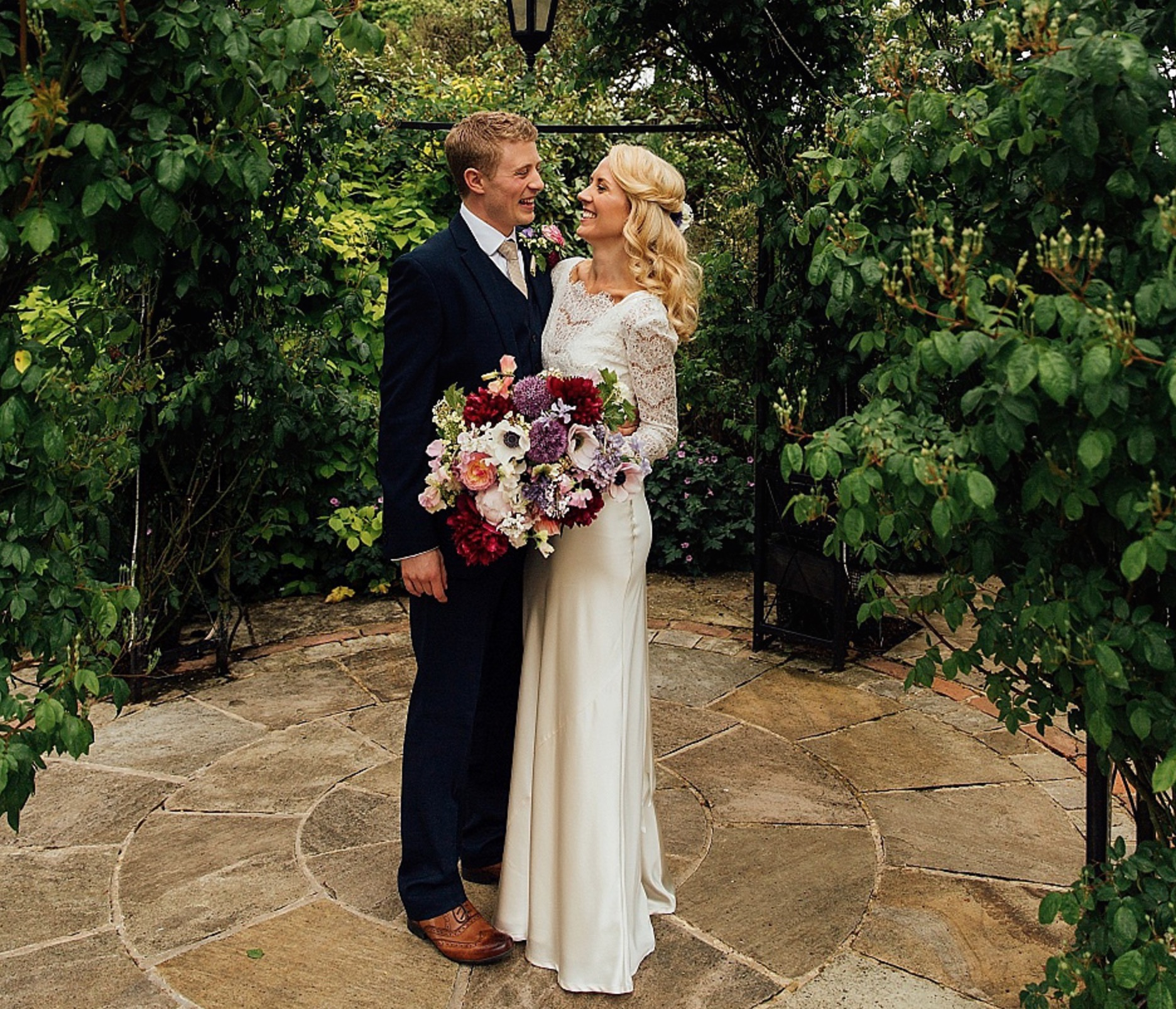 A Charlie Brear Gown for a Colourful, Flower Filled Barn Wedding