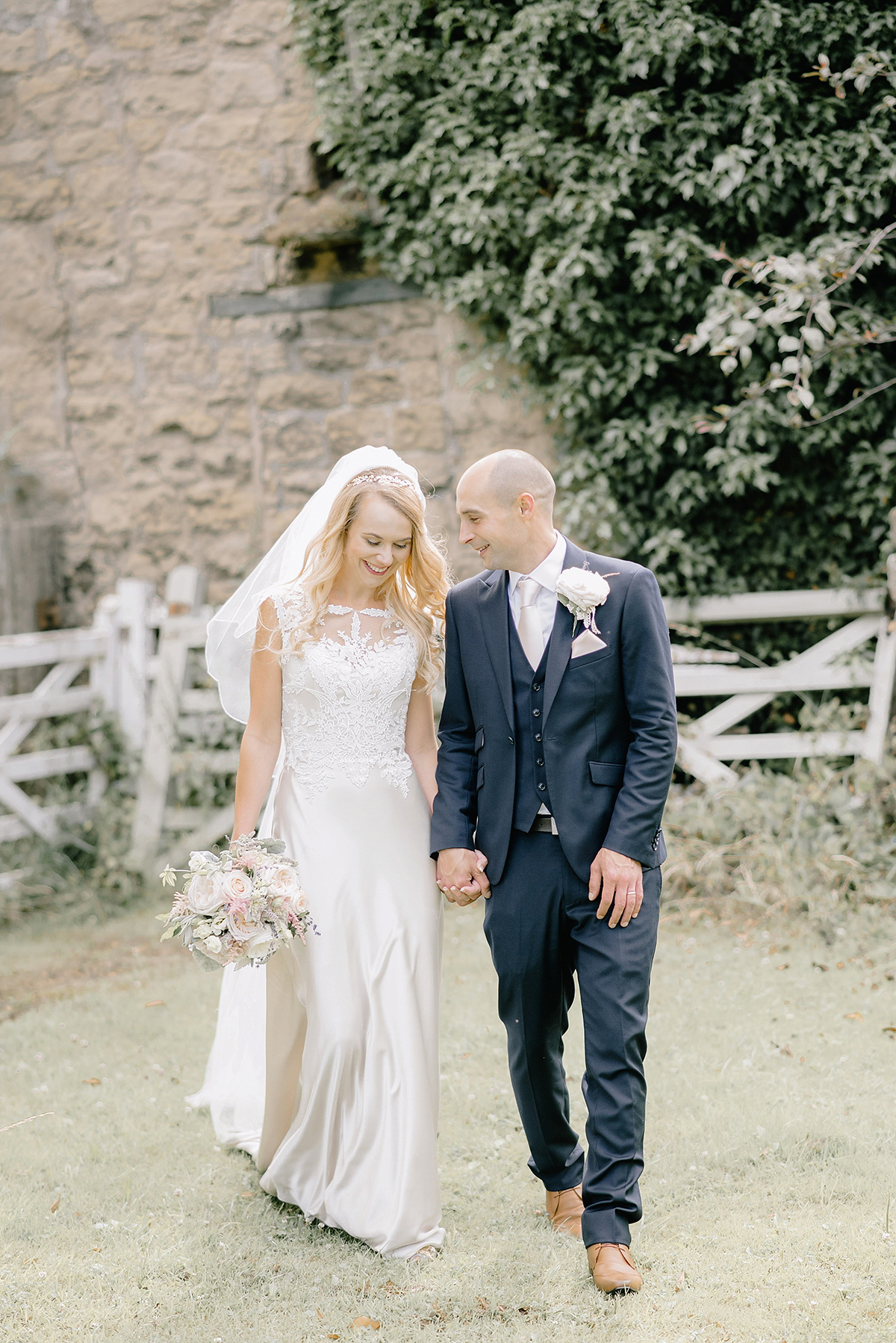 Dani wore a Justin Alexander gown for her relaxed and romantic English country wedding. Fine art film photography by Georgina Harrison.
