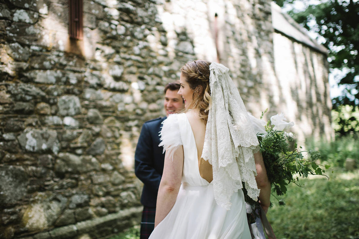 A Halfpenny London Gown with Feathered Sleeves for an Ethereal and Nature Inspired Wedding