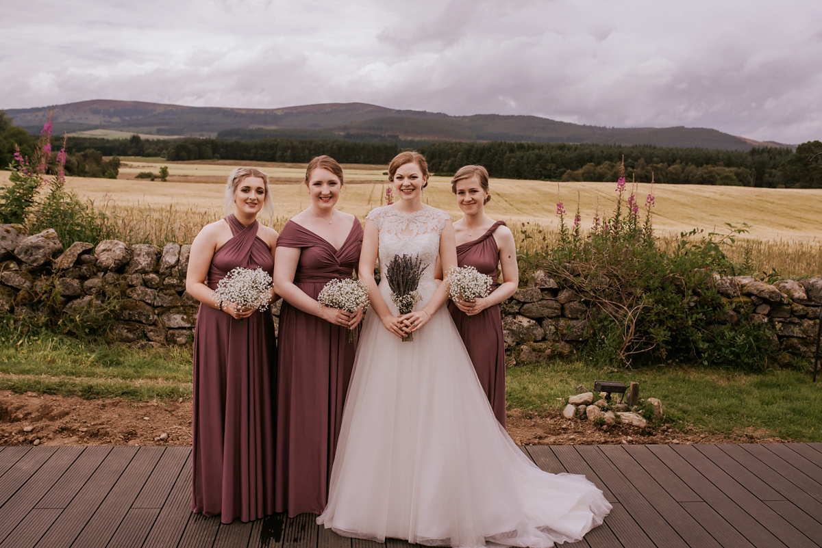 A Maggie Sottero Gown and Maids in Maroon