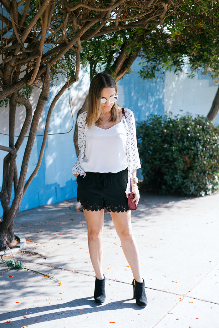 black white outfit with black booties and white cardigan kimono