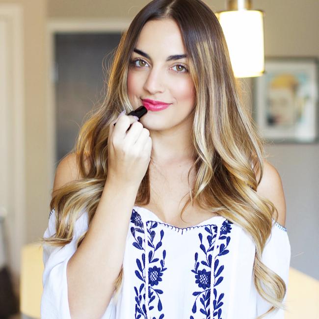 Olia applying lipstick