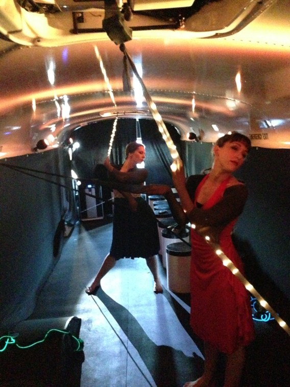 Brigette Cormier and Amanda Edwards posing in the bus before the audience arrives.