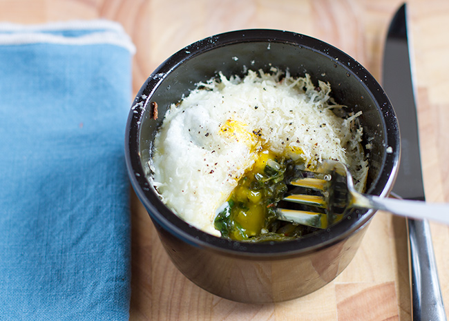 Baked eggs with spinach, chilli, and red onion