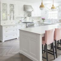 White Kitchen With Bleached Hardwood Flooring In ...