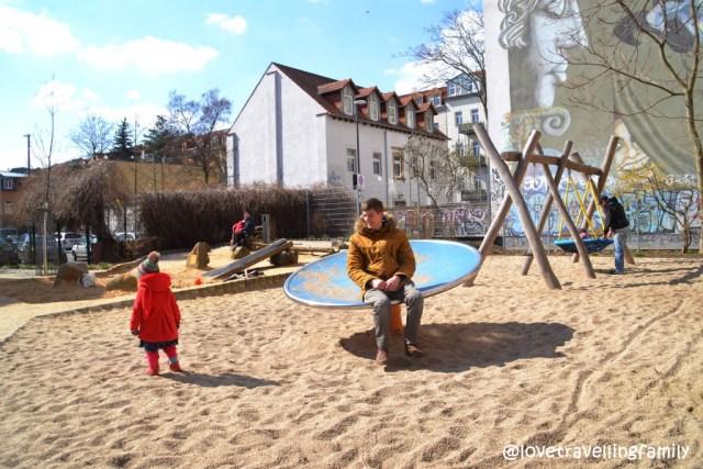 Lovetravelling family on the playground in Neustadt, Dresden, Germany