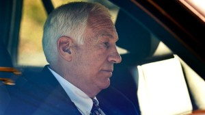 "Gerald ""Jerry"" Sandusky sits in a car as he leaves the office of Center County Magisterial District Judge Leslie A. Dutchcot, Nov. 5, 2011, in State College, Pa. (Andy Colwell/The Patriot-News/AP)"