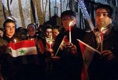 La preghiera di un gruppo di siriani cristiani