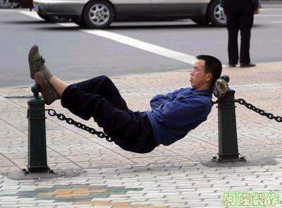 man sleeping on chain