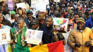 Manifestazione inItalia di senegalesi.