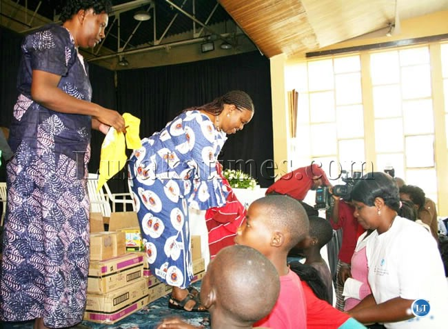 File:Gender and Child Development Division Permanent Secretary Edwidge Mutale (left) with Jesus Cares Ministries founder pastor Godfriday Sumaili donate clothes to orphans and vulnerable children during a luncheon organized for them in Lusaka