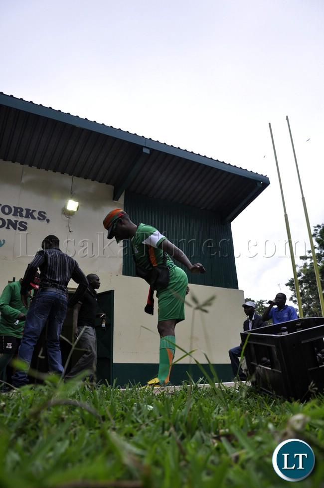 A soccer fan dancing before the Zambia-Bukina Faso match in Lusaka.
