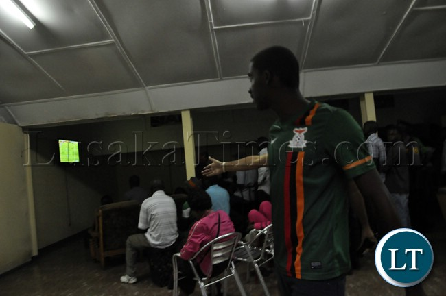 A soccer fan reacts after Zambia missed scoring opportunities during the match against Bukina Faso.