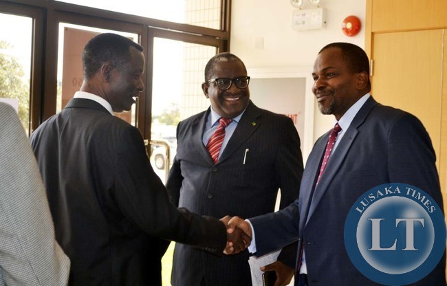 DIRECTOR of Public Prosecutions (DPP) Muntembo Nchito (right) shakes hands with Deputy Minister of Agriculture and Livestock Lackson Kazabu while Minister of Agriculture and Livestock Wylbur Simuusa (centre) looks on. This was shortly after Mr Simuusa announced the Crop Forecasting Survey (CFS) results at the Government Complex in Lusaka