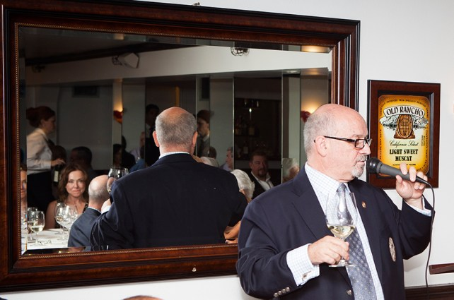 Event attendees are reflected in the downstair's dining room's large mirror.