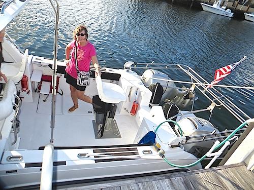 Karen inspecting her new boat.
