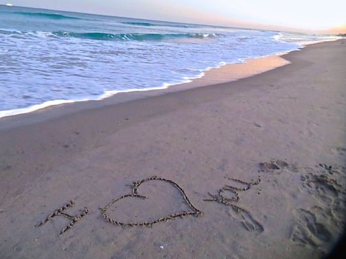 Karen gives me a sandy Valentine on Delray Beach at sunset.