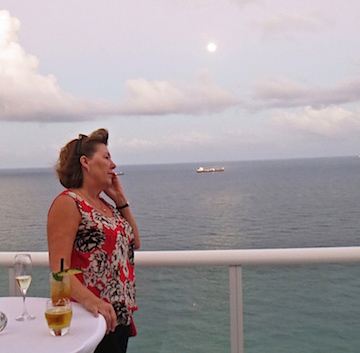 Karen takes a call on the W's penthouse balcony.