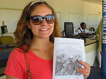 Nicole gets a crash course on how to read the daily race program and make wagers.