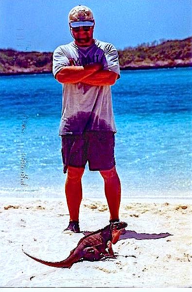 Capt. Ryan stares down a bold iguana on Leaf Cay, Exumas.