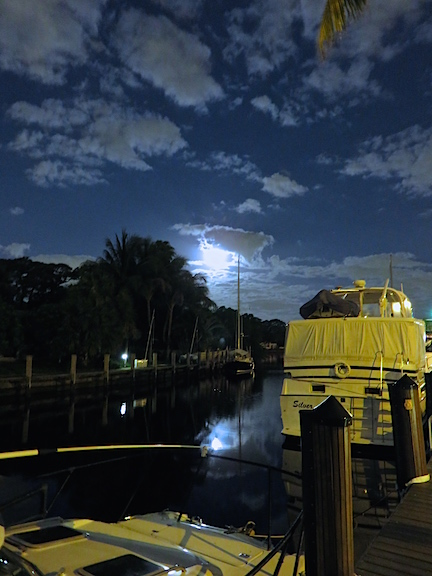 The full moon setting at the west end of our canal.