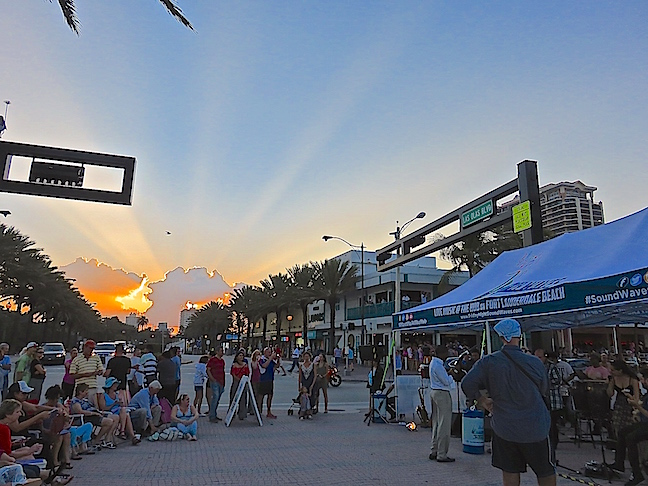 A beautiful sunset spilled down Las Olas Blvd. to usher in the night.