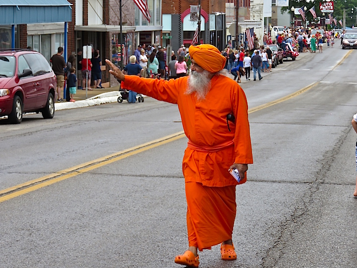 Lest you think there was no diversity, a Hare Krishna devotee from the local community was one of a dozen that proclaimed pride in being Americans. Note the matching Crocs in his orange ensemble.