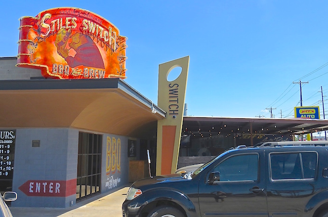 Violet Crown Shopping Center was Austin's first shopping center and its art deco arches went up in 1951. Stiles Switch BBQ and Brew arrived in 2011. The joint was named after the International and Great Northern railroad stop in Stiles Switch, Texas built in the 1800s.