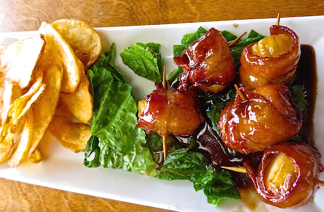 Every restaurant in town serves Digby scallops in some form. We sampled several, but I was hooked forever after scarfing down two orders of Digby scallops wrapped in bacon with honey, maple sauce at the unassuming Shore Line Restaurant and Gift shop.