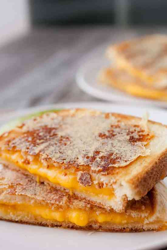 Parmesan Inside Out Grilled Cheese: This is some upper level grilled cheese sandwich business. After you cook the sandwich, coat it with shredded parmesan and cook it a second time until the crust is crispy. Crazy good.