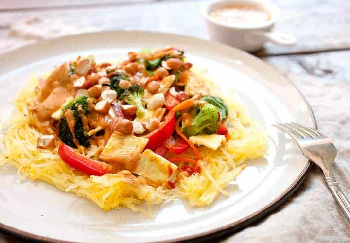 Thai Spaghetti Squash with Peanut Sauce: This roasted spaghetti squash is amped up with a veggie stir-fry topper, eggs, and a spicy homemade peanut sauce. EASY to make and perfect for fall! | macheesmo.com