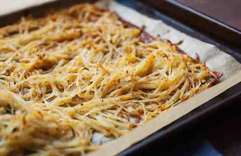 Sheet Pan Hash Browns: After much experimentation, this is the easiest and most failsafe way to make perfectly crispy (and flavorful) hash browns in the oven on a single sheet pan! You'll never stress over soggy potatoes again. | macheesmo.com