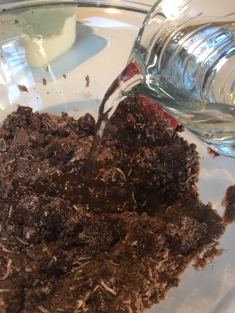 Mixing the batter for chocolate cake with coconut