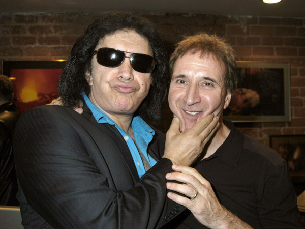 Musician Gene Simmons of KISS and producer Barry Levine attend the Grand Opening of Radical Publishing held at the Radical Publishing offices on February 19, 2009 in Los Angeles, California.