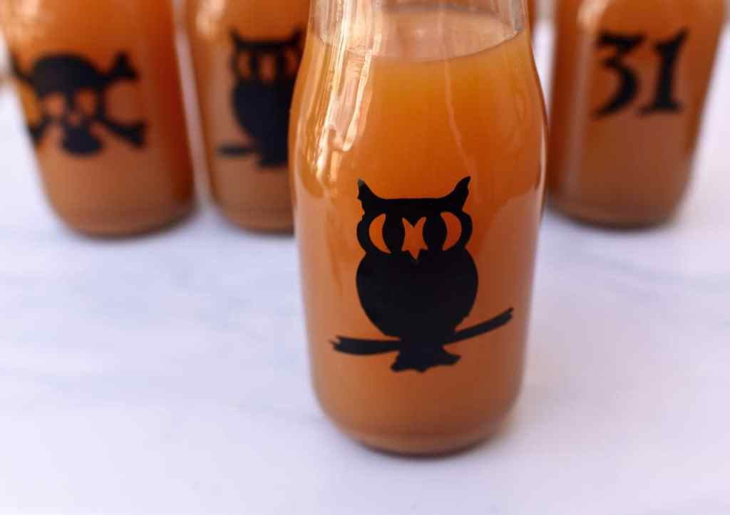 How to decorate milk glass bottles with vinyl for Halloween