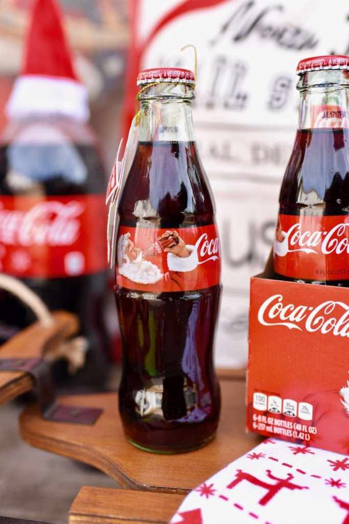 Coca-Cola glass bottles with vintage Santa