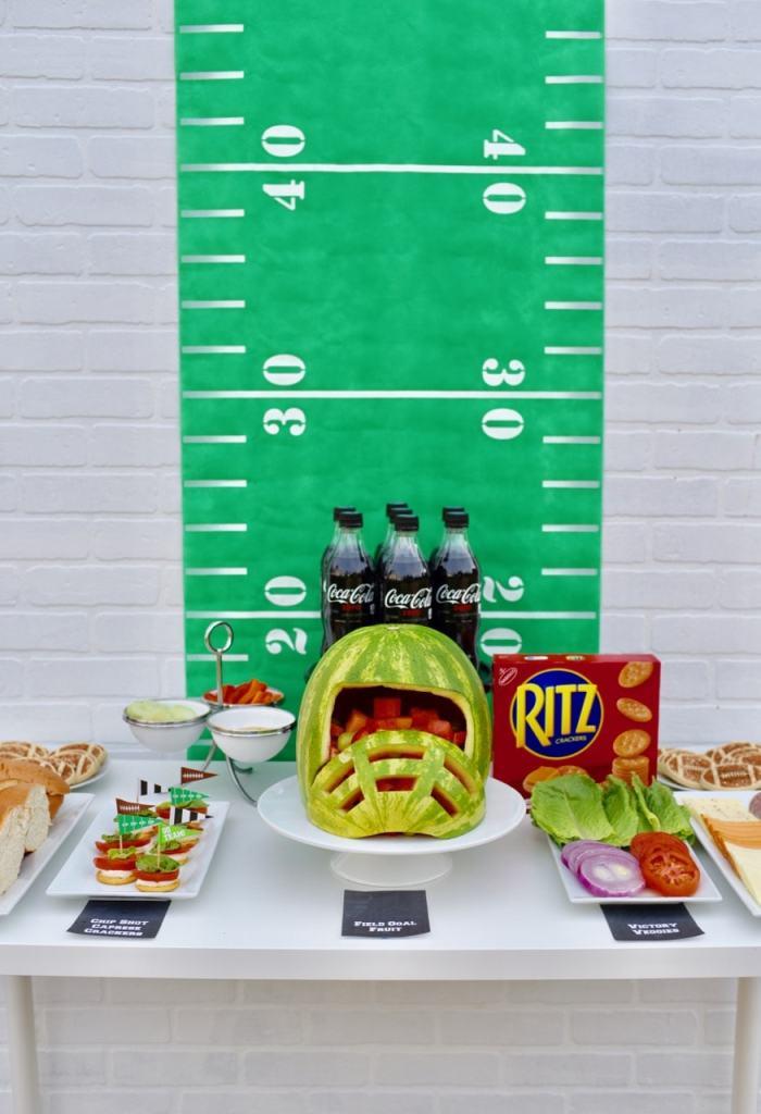 Healthy football party. LOVE the watermelon helmet!