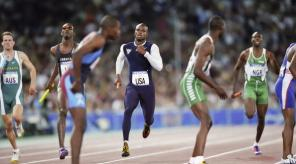 SYDNEY, AUSTRALIA -  SEPTEMBER 30, 2000:  Alvin Harrison of the U.S. approaches the exchange zone to handoff to his teammate Antonio Pettigrew during the final of the Men's 4x400m Relay event of  the Sydney 2000 Olympic Games on September 30, 2000 at Stadium Australia, Homebush Bay in Sydney, Australia. (Photo by David Madison/Getty Images)