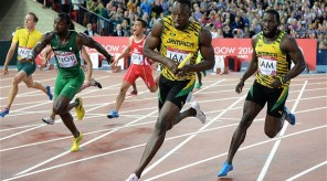 Nigeria's Obinna Metu waiting for his baton, while Usain Bolt had already gotten his. Photo Credit: Telegraph.co.uk