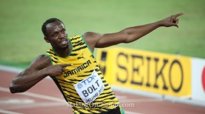 Usain Bolt strikes his famous 'Lightning Bolt' pose after winning his third 100m World title.