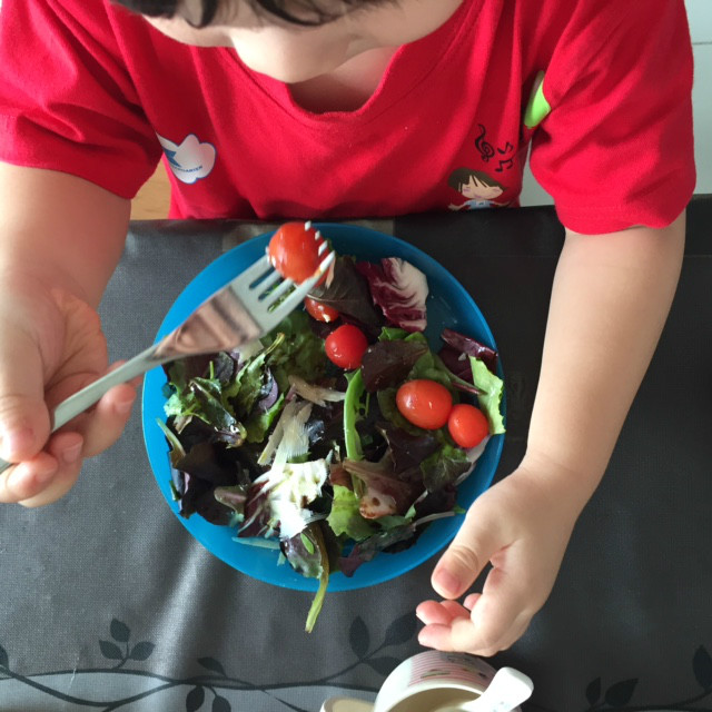 toddler eating salad