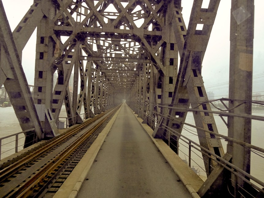 """Driving over the Sino-Korean Friendship Bridge"", (c) 2012 Roman Bansen-CC BY SA 2.0). Via Wikimedia."