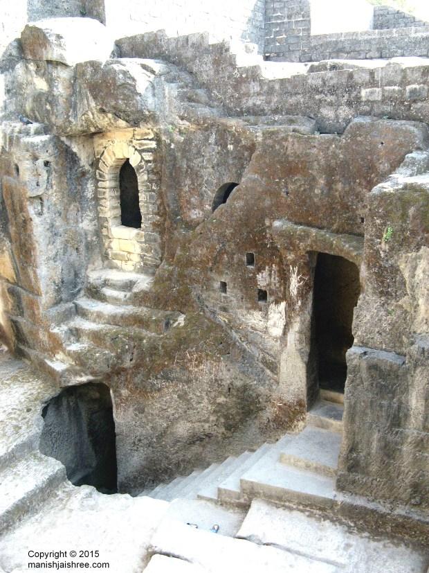 The three-tiered Buddhist cave complex, Uparkot, Junagarh