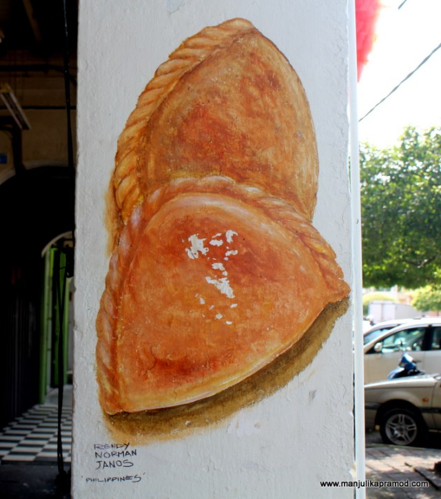 KKB kaya puffs painted on the pillar wall.