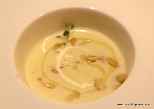 Soup of Luxurious white asparagus finished with truffle oil.