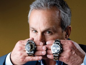 Paul Altieri, owner of Bob's Watches with a  a vintage 1955 Rolex Submariner, left,  estimated worth of $25,000 and a vintage 1966 Rolex Daytona, 'Paul Newman' worth an estimated $75,000