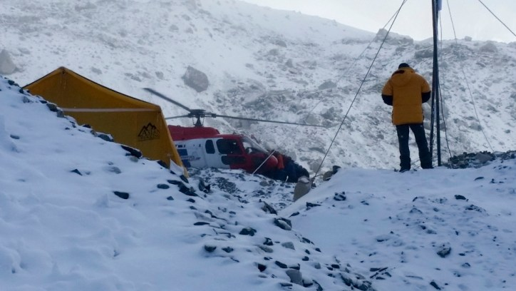 Mt Everest, April 26, 2015 : Helicopters arrive at the base camp of Mt Everest to airlift injured persons from the camp after an avalanche killed 16 people on Everest on April 25, 2015. (Photo by Praveen C M )