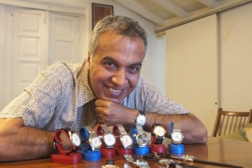 Suresh Venkat poses with his watch collecton